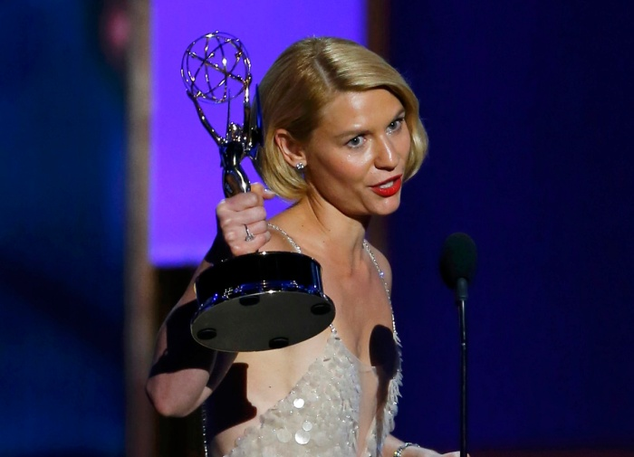 """Actress Claire Danes accepts the award for Outstanding Lead Actress In A Drama Series for her role in """"Homeland"""" at the 65th Primetime Emmy Awards in Los Angeles"""
