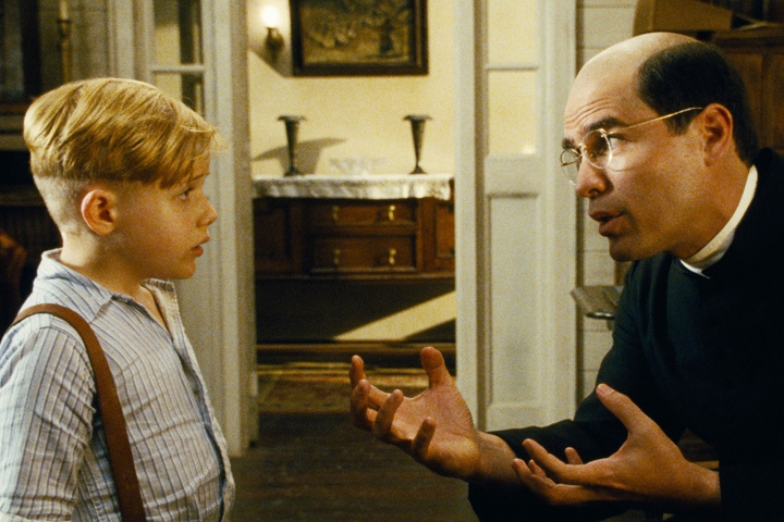 LITTLE BOY - 2015 FILM STILL - (Left to right) Jakob Salvati as Pepper Flynt Busbee and Eduardo Verastegui as Father Crispin - Photo Credit: Andrew Cadelago / Open Road Films