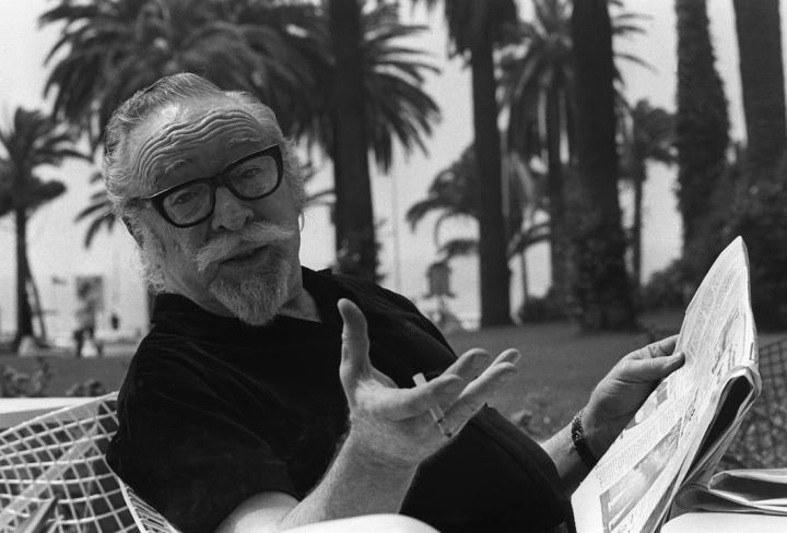 "CANNES, FRANCE: American movie director Dalton Trumbo pose for photographer 17 May 1971 in Cannes as he presents his latest movie ""Johnny Got His Gun"". Trumbo (1905-1976) was a victim of the anti-Communist witchhunt campaign instigated by John Parnell and Senator Joseph McCarthy between 1947 and 1954. In 1947 Trumbo was condemned by the HUAC (House Un-American Activities Committee) along with nine other Hollywood personalities. The group is known as the ""Hollywood Ten"". In the 1960's Trumbo could work again under his real name thanks to the intervention of actor Kirk Douglas. (Photo credit should read AFP/Getty Images)"