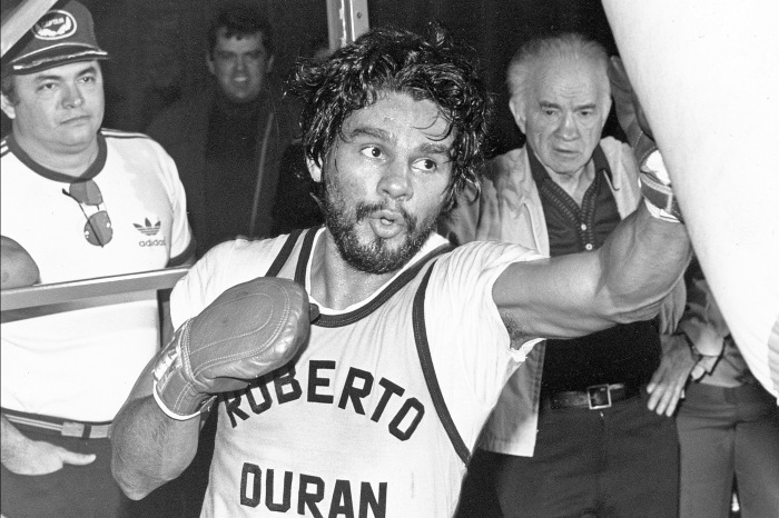 U.S. WBC welterweight champion Roberto Duran hits the speed bag as his veteran trainers, Freddie Brown, left, and Ray Arcel, right, watch during a workout for his title rematch with U.S. Sugar Ray Leonard, New Orleans, LA, Nov. 15, 1980. (AP Photo)